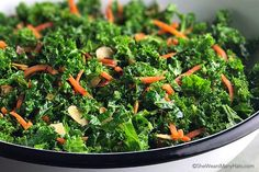 Garlicky Orange Kale Salad, with toasted almonds and grated carrots, is a delicious side dish and is packed with Vitamin A and Vitamin C.