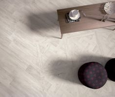 CERAMICHE ARIANA presenta la Nuova Linea LARIX in gres porcellanato effetto legno con inserti Tarsie . Fondo 20x80 cm in vendita a Euro 28,16 /mq Iva Inclusa in sede o nel nostro sito www.ceramicheroma.com