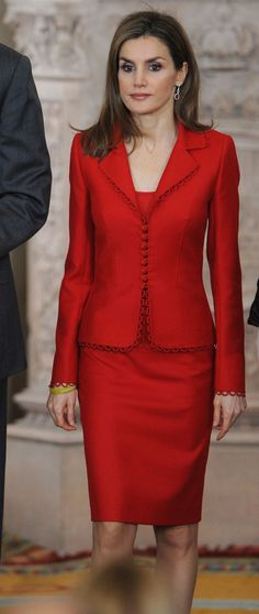 Queen Letizia recycled a Felipe Varela separates outfit.  It consists of a red jacket with scallop edges and a matching pencil skirt. She wore her ruby and diamond dangle earrings. King Felipe VI and Queen Letizia of Spain at the Investigation National Awards at Madrid's Royal Palace today 15 January 2015
