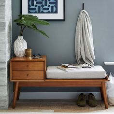 Entryway Design Ideas - 3 Different Styles Of Entryway Benches // This bench has a small table with two drawers attached to it creating the perfect drop zone for keys, glasses, and bits of paper you fish out of your pockets when you get home.