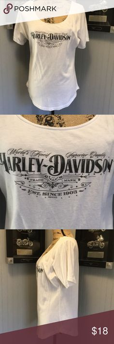 "Harley Davidson T-Shirt EUC. A very cute tee with shirt tail hem. Small rhinestones on the front. Dealership name on the back. Length 24"". Armpit to armpit 19"" Harley-Davidson Tops Tees - Short Sleeve"