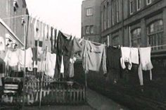 A mangle standing in front of the washing in Birmingham's back-to-backs.