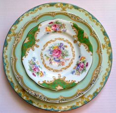 Mismatched china plates and dishes :