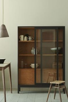 Glass door cabinet, love the glaze and timber interior combo: