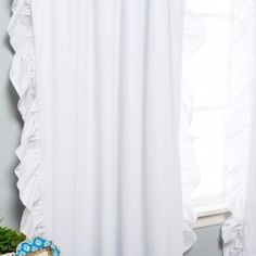Soft and feminine ruffles are a gorgeous addition to any roomBlackout lining features an innovative triple weaved fabric for thermal insulated blackout curtains.Front: 100% Cotton Twill   Back: 100% PolyesterClassic rod pockets create a clean and tailored look on a standard or decorative rod.Measurement : Each panel measures 52