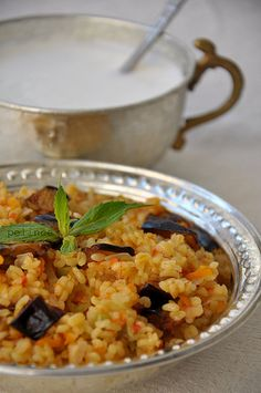 Bulgur Pilavı & Ayran - I like to put currants, sunflower seeds and onions in mine and top it with toasted almonds.  Lots of spice: cinnamon, allspice, cumin and kirmizi biber.