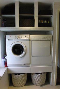 mooi opgeruimd en de wasmachine en droger op werkhoogte