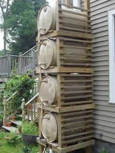 """Rain barrel """"tower"""" for added capacity and pressure. I need to figure out some rain barrel system to store water for the horses so I don't have to lug so much. I've got three nice steel barrels, just need to figure out how to hook them up. Outdoor Projects, Garden Projects, Water Collection, Rainwater Harvesting, Water Storage, Dream Garden, Homesteading, Outdoor Gardens, Landscape"""