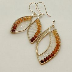 Izabella Bako Petra  Hessonite garnet rondelles wrapped in fine and sterling silver.