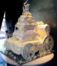 Fairytale Carriage CAKE~OH MY GOODNESS!!!!!  3-D constructed carriage covered in fondant and buttercream with all edible stacked pillows of cake, white chocolate and fondant~AMAZING