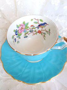 Blue teacup with scene inside