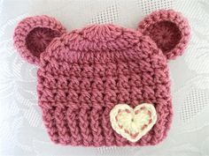 Crochet baby girl bear hat with heart. This cute baby hat is perfect for newborn pics or everyday use. I made the hat with soft acrylic yarn. This hat is available in size 0-3 months. If you need it in different colors and size, please message me. Care instructions: hand wash in cool water and lay flat to dry. All my hats are made in smoke and pets free home. Thanks for visiting!