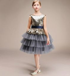 Sequin Tiered Dress-Made To Order - High Quality Unique Design Sparkle Sequin Round Neckline Sleeveless Knee Length Infant Toddler Little & Big Girl Tiered Layered Tutu Dress. Available from 5 -16 years. Material: Cotton. Color: Gray Tile. Please do compare your little girl measurements with our size chart below or you may leave a note your little girl's height, bust and waist measurements so we can process it and send you the right size.