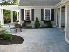 bluestone patio, house color and black shutters