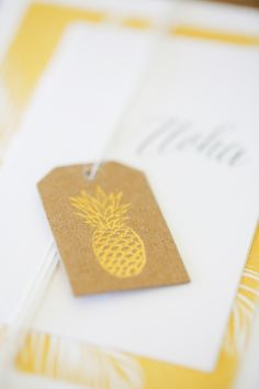 Tropical Stacked Wedding Invitations featuring Gold Foiled Pineapple Luggage tags made of craft paper and tied with natural twin. Destination Beach Wedding of Kimberly Lapides of www.eatsleepwear.com Maui, Hawaii at the Olowalu Plantation House