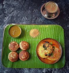 """Sorghum / Cholam Paniyaram Sambar Idli (ghee tadka poured over) Curry Leaves Chutney Masala Tea…"""
