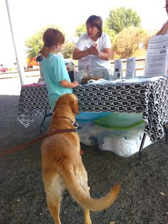 Handing out Info and dog cookies at Farm Stand
