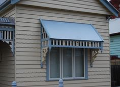 My Honey....this would be the perfect door awning...with railings & Pickett fencing around the patio...