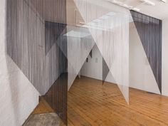 White and black chain fly curtains are made into triangular shape, hanging from…