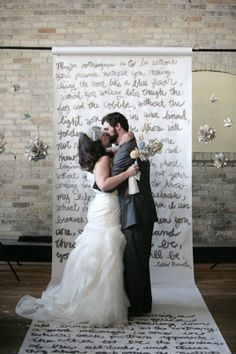 Song lyrics for a background at our rockstar wedding!!! Lovin this idea since some of our songs would scare gramma! ;)