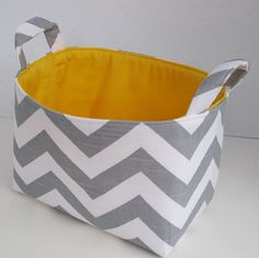 Small fabric basket in perfect grey/white chevron with yellow lining.