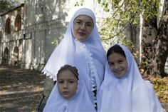 Russian Orthodox Christian mother and daughters.