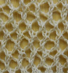 CLIMBING LACE TRELLIS  Cast on an odd number of stitches.  Rows 1 and 3: Purl.  Row 2: K1, *yo, k2tog, repeat from * to end of row.  Row 4: *Ssk, yo, repeat from * to last stitch, k1.  Repeat Rows 1 - 4.