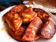 """Pastel com o Diabo Dentro (Portuguese empanada) - This appetizer from Cape Verde gets its name from the hot peppers in the filling, and the Portuguese name of this dish means """"pastry with the devil inside."""" , It is unusual in that the pastry is made from sweet potatoes and corn meal. The filling is fresh tuna, chiles, onions, and tomatoes."""