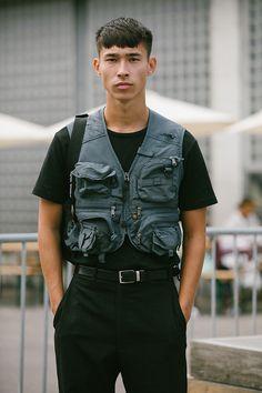 5610cc6cb34a4 A utility vest puts a very modern military twist on a simple black T-shirt