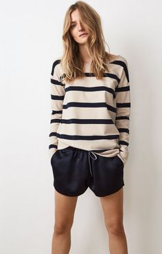 Striped plain knit sweater with boat neck. Cut for a straight, mid-length silhouette with long sleeves and slit at cuffs. Rolled edge at neckline. Team Lillian Knit with Pearl Shorts. Color as on product picture. Model is 174 cm and is wearing a size S.82% Cotton, 18% Elastane
