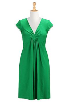 Color: Jade green Expertly pleated front with a quilted diamond panel shapes the flattering bodice of our cotton knit dress cut with an elastic back waist for a slimming silhouette. Slips on over head. Deep V-neck. Set-in cap sleeves. Knee length. Cotton/spandex, jersey knit, light stretch, midweight. Machine wash