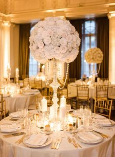 Featured Photographer: Megan Clouse Photography; elegant white ballroom wedding centerpiece