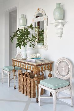 Airy Entry - Tour This Breezy South Carolina Beach House - Southernliving. Even the owners' cherished 19th-century, marble-topped console with gilt carvings found a place in the beach house: Keenan flanked it with a pair of wicker hall chairs by Soane Britain, and hung a whimsical new shell mirror above it.