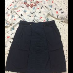 ONE HOUR SALE❤️Anthro navy skirt Adorable navy blue skirt with side pockets, front ripple detail, and black rope edging at waistline. Button accents, back zipper. No flaws! Girls from Savoy, by Anthropologie. Anthropologie Skirts Pencil