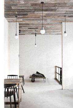 I love this wooden plank ceiling. I like it even more if they are salvaged.