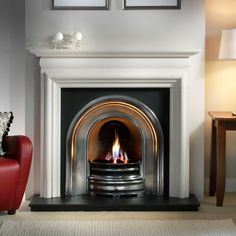 Limestone Fireplace with Crown Cast Iron Arch