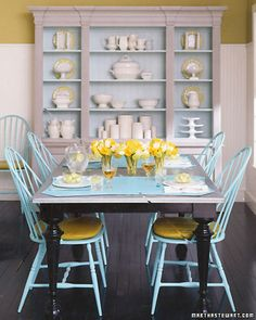 blue windsor chairs, dark table, white hutch with blue interior - I would change the yellow accents