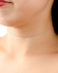 Dainty Oval Beads Choker Necklace!  A delicate oval and round beaded sterling silver or gold plated sterling silver chain adjustable from 10,6 to 14,6 (27 to 37 cm), perfect for everyday use as a single or a layering necklace.  Round bead diameter: 0,07 (1,8mm) Oval bead dimensions: 0,06