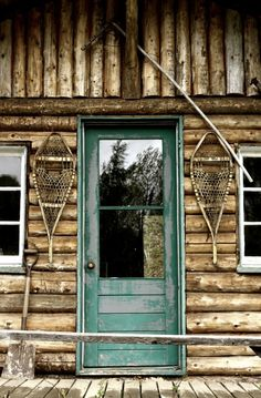 Cabin life, back door with snowshoes at the ready..