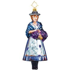 "The latest in our annual Broadway Legends ornament series is the loverly Julie Andrews as the guttersnipe Eliza Doolittle in My Fair Lady. Draped in a navy blue shawl and wearing her artfully distressed apron and skirt, our violet-selling Cockney heroine dreams of a better life somewhere, ""far away from the cold night air."" This 6"" tall glass ornament is the sixth in our series, created exclusively for BC/EFA by the folks at Christopher Radko. $55"