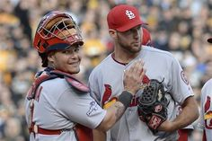 Yadier Molina pats starting pitcher Michael Wacha right before he was lifted in the eighth inning of Game 4 of the NLDS.  The Cardinals held on to their 2-1 lead, and Wacha got the win!