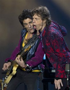 (AP Photo/Eduardo Verdugo). The Rolling Stones' Ron Wood, left, and Mick Jagger perform during their Ole Tour at Foro Sol in Mexico City, Monday, March 14, 2016.