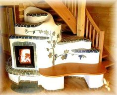 totally awesome fireplace with a bench and steps for my cats and dogs. :) ~JP