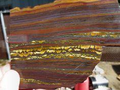 http://agetrail.com/imgs/a/a/p/u/k/rfm_chatoyant_gold_tiger_eye_tiger_iron_hematite_slab_rough_australia_beads_cabs_6_lgw.jpg