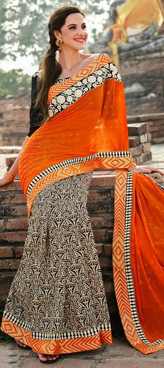 133632: Peppy orange color blocks the prints in this #saree.