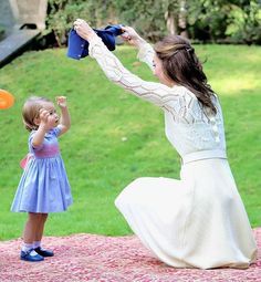 Catherine, Duchess of Cambridge bends down  AGAIN and Princess Charlotte at a children's party for Military families during the Royal Tour of Canada on September 29, 2016 in Victoria, Canada. .