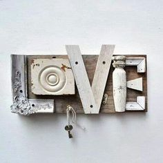 Upcycled wooden salvaged pieces spell out the word LOVE, key hook; Upcycle, recycle, salvage, diy, repurpose!  For ideas and goods shop at Estate ReSale  ReDesign, Bonita Springs, FL