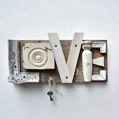 """"""" Sur toutes les pages lues, sur toutes les pages blanches, pierre, sang, papier ou cendre, j'écris ton nom"""" ( Paul Eluard pour le mot Liberté  ) / Upcycled wooden pieces spell out the word Love."""