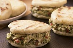 """Arepas define Venezuelan cooking. These thick cornmeal patties are griddled, then baked, and then stuffed while warm with anything from white cheese to this zesty chicken salad with avocado mayonnaise (Johan Santana's first choice). The salad is named in honor of Susana Duijm, Miss World in 1955 and a popular Venezuelan celebrity. (Reina means """"queen"""" in Spanish, and pepiada is perhaps most politely translated as """"curvy."""") The recipe comes from Maribel Araujo of New York's always-packed…"""