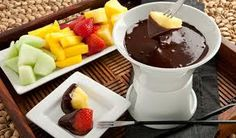 Ah yeah!-  Dark chocolate fondue with fruit-- plus two other delectable, easy recipes for those who want to whip up your own Valentine's day meal.  We're wild for these, enjoy! :)